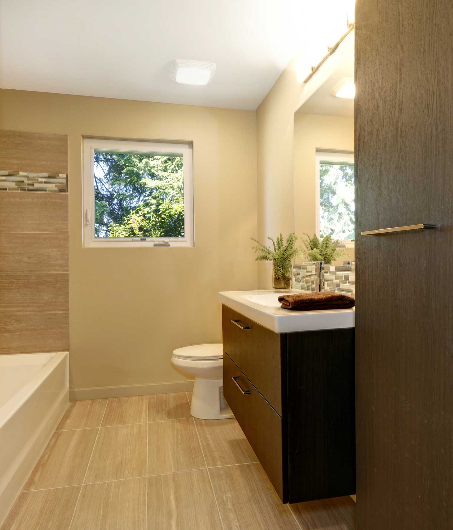 dark wooden cabinet in a bathroom