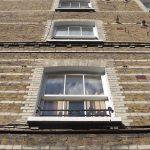 sash windows on a brick townhouse