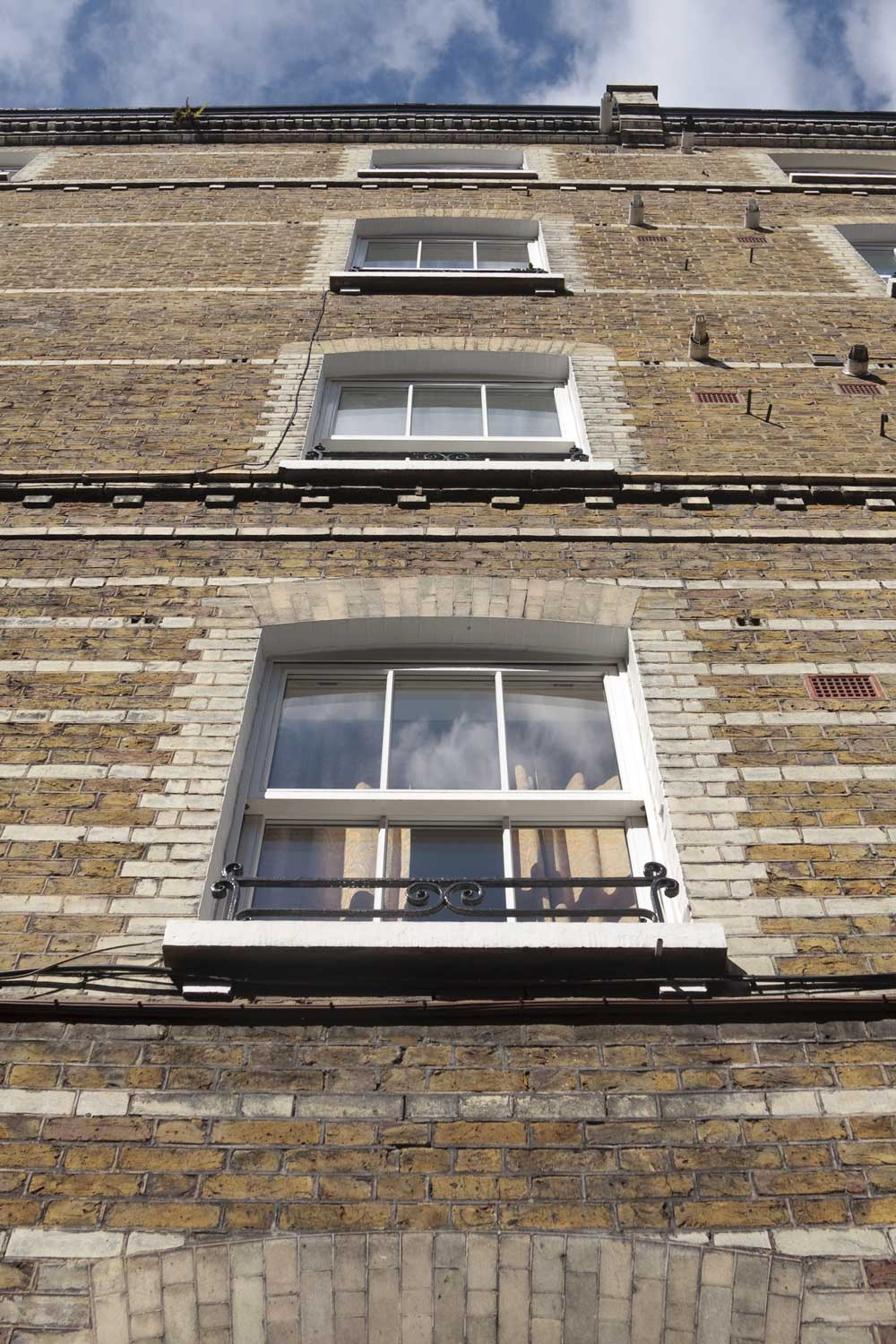 sash windows on a brick townhouse