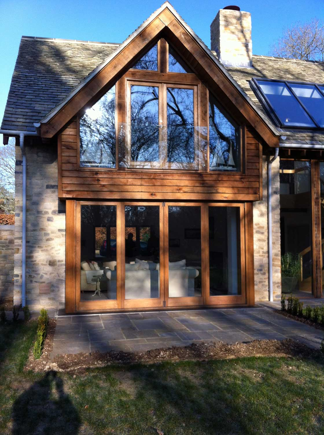 windows and wooden bi-fold doors