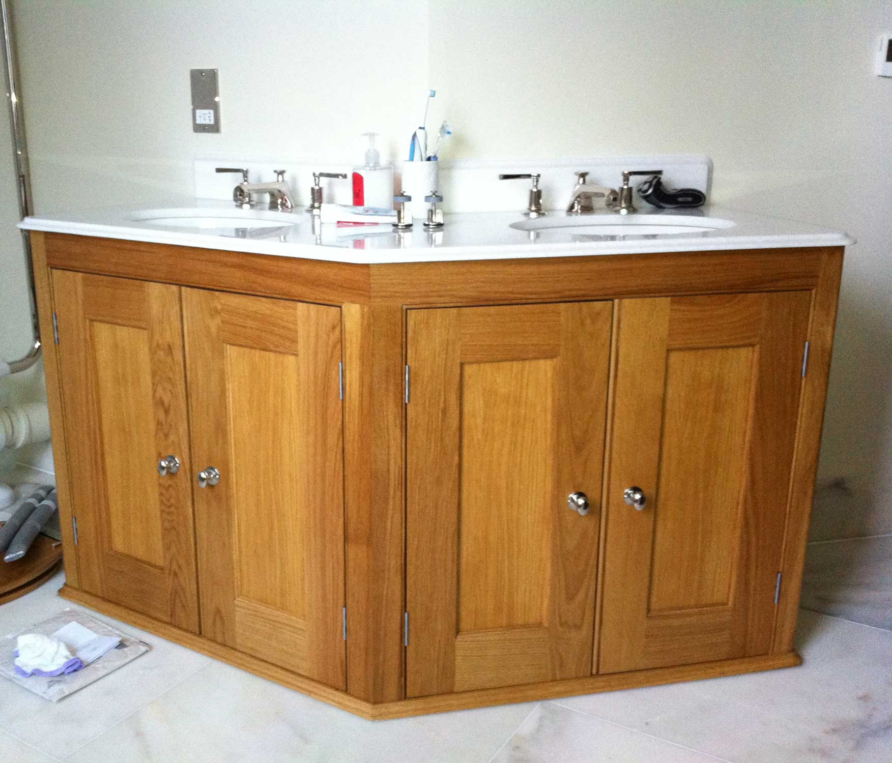 wooden cabinet with sink on top