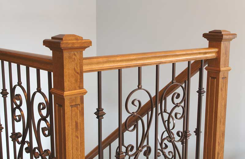 Wooden staircase with metal baluster