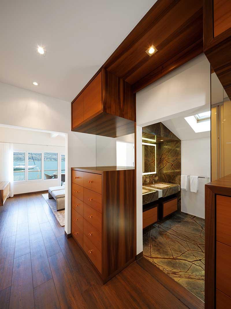 Modern house interior, corridor overlooking bathroom